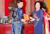 "MRS. NGUYEN THI DOAN- VICE PRESIDENT OF SOCIALIST REPUBLIC OF VIETNAM GAVE MEMORIAL MEDAL TO DR. TRAN DUC HANH- CHAIRMAN AND CEO OF MARPHAVET AT THE CEREMONY HONORING ""HO CHI MINH AGE'S CULTURAL ENTERPRISES- ENTREPRENEURS"""